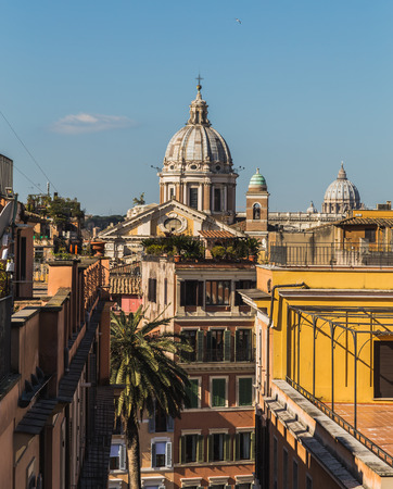 spanish steps: ROME, ITALY - 12TH MARCH 2015: A far view of buildings from the Spanish Steps in Rome during the day. A church can be seen in the distance.