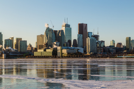 td: TORONTO, CANADA - 16TH JANUARY 2015: A view of the Toronto skyline during the winter months. Ice can be seen on Lake Ontario. Editorial