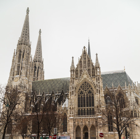 votive: The outside of the Votive Church in Vienna during the day in the winter