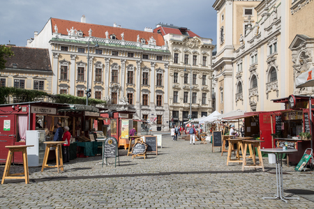 innere: Market Stalls in a cobbled square in the Innere Stadt of Vienna during the day.