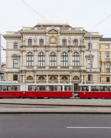31st: Vienna, Austria - 31st January 2016: A view of old trams and buildings along Scwarzenberglatz in Vienna during the day. People can be seen. Editorial