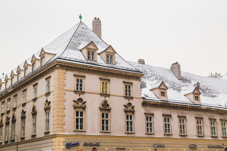 stephansplatz: VIENNA, AUSTRIA - 5TH JANUARY 2016: A view of buildings in Stephansplatz in the winter. Snow can be seen on the roofs.
