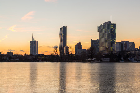 oxbow: VIENNA, AUSTRIA - 29TH JANUARY 2016: A view of buildings in the Donaucity in Vienna. Taken in the winter at sunset. Editorial
