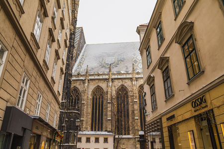 innere: VIENNA, AUSTRIA - 5TH JANUARY 2016: Part of St. Stephens Cathedral (Stephansdom) in Vienna from Churhausgasse during the winter. Snow can be seen on the building. Editorial