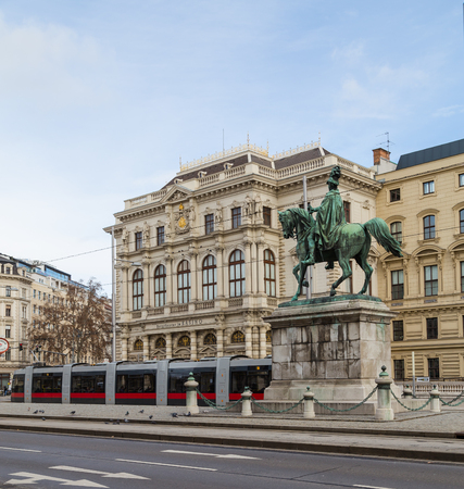 innere: Vienna, Austria - 31st January 2016: A view of new trams and buildings along Scwarzenberglatz in Vienna during the day. People can be seen.