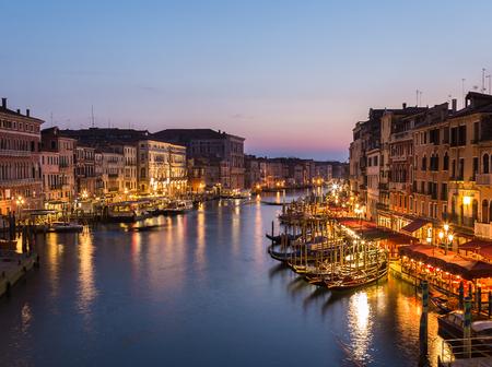 rialto bridge: VENICE, ITALY - 14TH MARCH 2015: Venice Cityscape from Rialto Bridge showing buildings and restaurants.