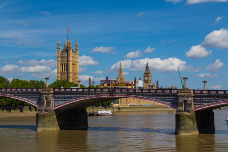 tour bus: LONDON, UK - 18TH JULY 2015: Lambeth Bridge in London during the summer. The River Thames, Westminster and a Big Bus Tour Bus can be seen.
