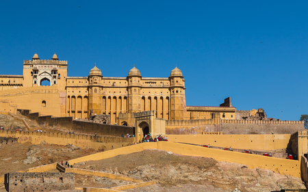 amber fort: JAIPUR, INDIA - 22ND MARCH 2016: The outside of the Amber Fort in Jaipur, Rajasthan, India. Elephants and people can be seen.