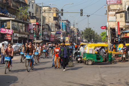 DELHI, INDIA - 19TH MARCH 2016: Roads and streets of Delhi during the day. People on bikes, Tuk Tuks and pedestrians can be seen.