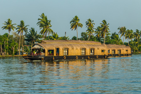 backwaters: KERALA BACKWATERS, INDIA - 1ST APRIL 2016: Traditional houseboats in the Kerala backwaters of south India during the day. People can be seen.