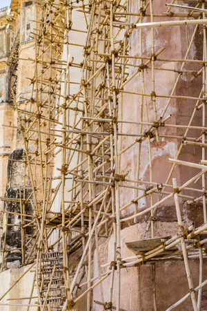 scaffolds: Scaffolding at the side of a wall in India made from Bamboo