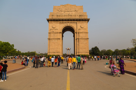 india gate: DELHI, INDIA - 19TH MARCH 2016: The outside of the India Gate War Memorial during the day. Large amounts of people can be seen outside and around it.