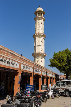 low angle views: JAIPUR, INDIA - 23RD MARCH 2016: Low angle view of the Ishwar Lat or Swarg Suli Tower in central Jaipur during the day. Walking to the top offers high views of the city.