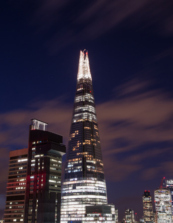 shard: LONDON, UK - 26TH MARCH 2015: The outside of the Shard and other buildings in London near Tower Bridge at night.