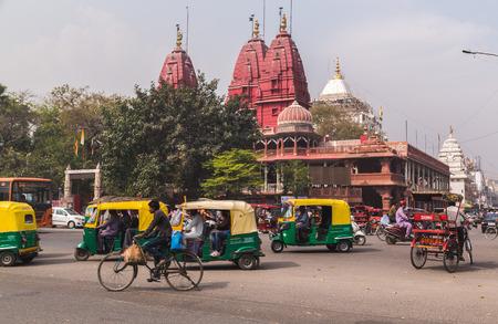 shri: DELHI, INDIA - 19TH MARCH 2016: A view of streets and the Shri Digambar Jain Lal Mandir Temple in Delhi. Lots of Tuk Tuk Rickshaws and traffic can be seen.