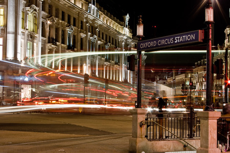 subway entrance: LONDON, UK - 19TH APRIL 2013: A view of Oxford Circus in central London at night. An entrance to the subway can be seen.