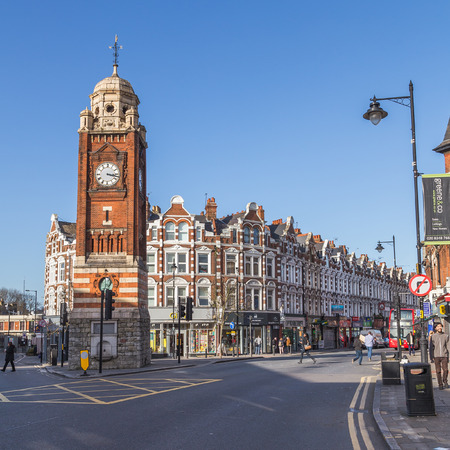 crouch: LONDON, UK - 10TH MARCH 2015: The clock Tower and Streets in Crouch End, North London. People and traffic can be seen.