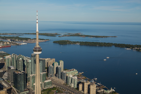 lake front: TORONTO, CANADA - 6TH JUNE 2015: A view towards Lake Ontario from the Air showing some buildings in downtown Toronto, The CN Tower and the Island Park.