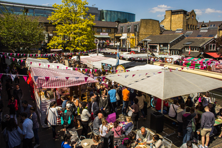 LONDON, UK - 27TH MAY 2013: A view of food stalls at Camden Market during the day. Lots of people can be seen.