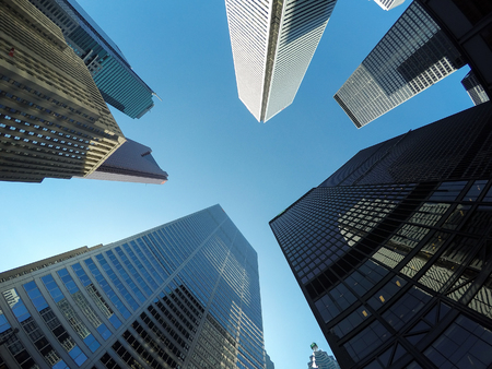 low  angle: TORONTO, CANADA - 4TH JUNE 2015: A low angle view of buildings in downtown Toronto during the day.