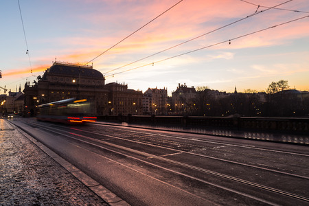 december sunrise: PRAGUE, CZECH REPUBLIC - 6TH DECEMBER 2015: Colourful Sunrise in Prague. The outside of buildings and traffic can be seen.