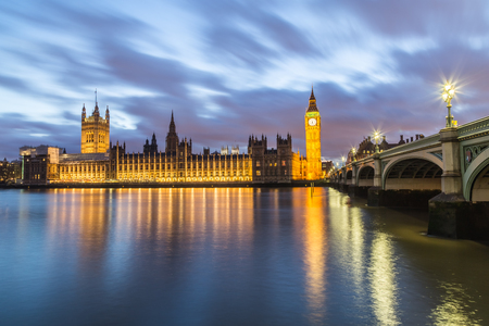 westminster bridge: Houses of Parliament from across the River Thames at dusk. Part of Westminster Bridge can be seen.