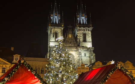 town square: PRAGUE, CZECH REPUBLIC - 6TH DECEMBER 2015: Church of Our Lady before Tyn and Christmas Tree at Old Town Square in Prague at night.