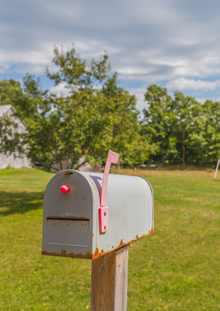 correspond: Delivery Box in Canada that has the Red flag up indicating mail.