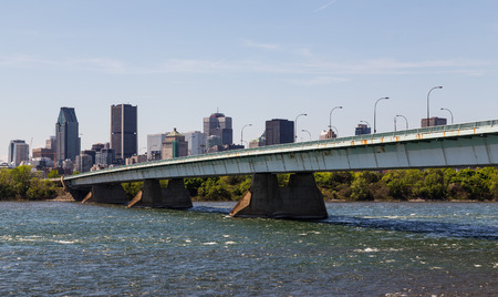 concorde: A view of downtown Montreal during the day showing the Pont de la Concorde bridge, buildings and offices.