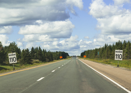 nova scotia: Signs on a highway in Nova Scotia warning of the maximum speed limit of 110