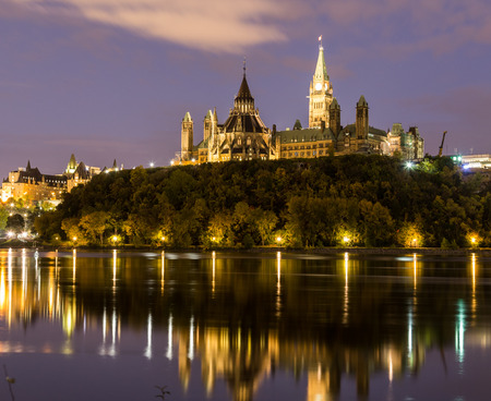 Parliament Hill in Ottawa at night from across the Ottawa River Stock Photo