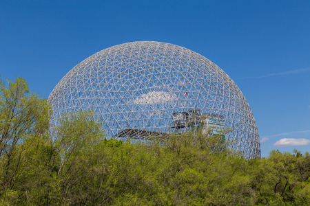 dome: MONTREAL CANADA - 17TH MAY 2015: The outside of the Biosphere Museum during the day showing part of the dome.