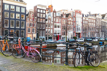 real renaissance: AMSTERDAM, NETHERLANDS - 16TH FEBRUARY 2016: A view of buildings, bridges  and bikes along the Amsterdam Canals.