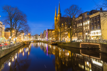 dutch canal house: AMSTERDAM, NETHERLANDS - 16TH FEBRUARY 2016: A view along the Keizersgracht canal in Amsterdam at night. Reflections, buildings, bikes and cars can be seen. Editorial