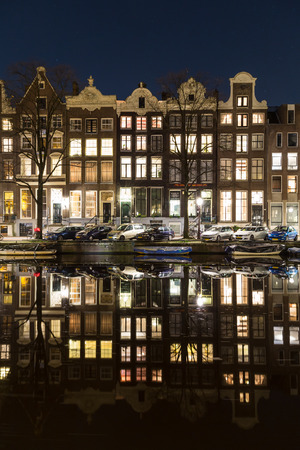 dutch canal house: AMSTERDAM, NETHERLANDS - 16TH FEBRUARY 2016: The outside of buildings in central Amsterdam at night.