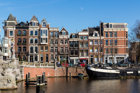 amstel: Buildings over the Amstel canal in Amsterdam during the day.