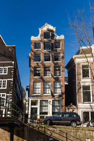 real renaissance: AMSTERDAM, NETHERLANDS - 16TH FEBRUARY 2016: Tall narrow buildings in central Amsterdam during the day. Editorial