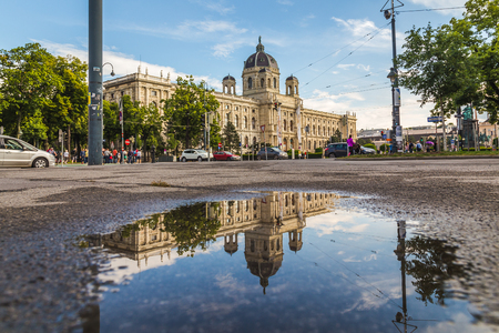 innere: VIENNA, AUSTRIA - 12TH JUNE 2016: The outside of the KH Museum in Vienna. Reflections can be seen in a puddle. People can be sen in the distance. Editorial