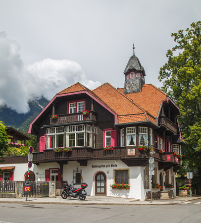 innsbruck: INNSBRUCK, AUSTRIA - 18TH JUNE 2016: The outside of a beautiful building on a street in Innsbruck during the day. Editorial