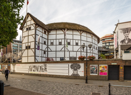 globe theatre: LONDON, UK - 6TH JULY 2016:  A view of the outside of Shakespeares Globe Theatre in the morning. A person can be seen.