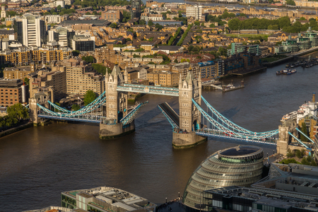 raised viewpoint: LONDON, UK - 5TH JULY 2016: A view towards Tower Bridge whilst the bridge is raised to allow boats to travel through it. Editorial