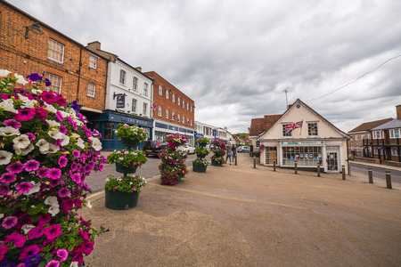 british weather: BUCKINGHAM, UK - 4TH JULY 2016: A view of Buckingham Town center during the day. People can be seen.