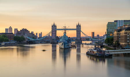 hms: LONDON, UK - 6TH JULY 2016: A view towards Tower Bridge and HMS Belfast in the morning. A colourful sky can be seen.