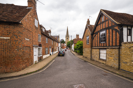 buckingham: BUCKINGHAM, UK - 4TH JULY 2016: A view along streets in the old part of Buckingham Town during the day. The outside of buildings can be seen. Editorial
