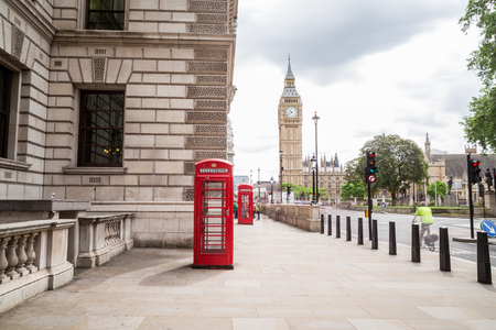 telephone: LONDON, UK - 28TH JUNE 2016:  A view towards Big Ben and Elizabeth Tower during the day. Red Telephone boxes and people can be seen in the foreground.