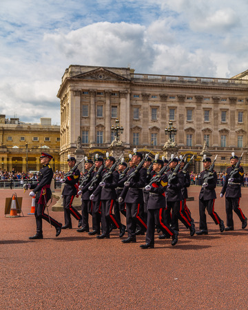 buckingham palace: LONDON, UK - 28TH JUNE 2016:  Soldiers at the Changing of the Guard Performance at Buckingham Palace in the summer