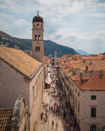 DUBROVNIK, CROATIA - 11TH AUGUST 2016: A view along Stradun street in Dubrovnik during the day showing the blur of large amounts of people