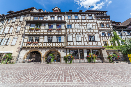 framed: COLMAR, FRANCE - 30TH JULY 2016: A view of timber framed buildings in Colmar, Alsace during the day