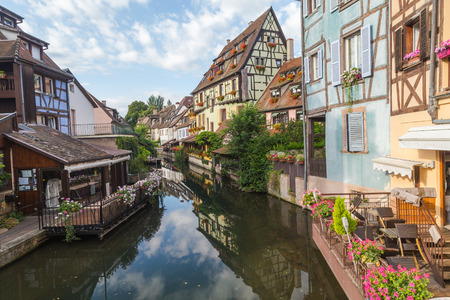 rue: COLMAR, FRANCE - 30TH JULY 2016: A view of colourful timber framed buildings near Rue Turenne at La Petite Venise in Colmar during the morning