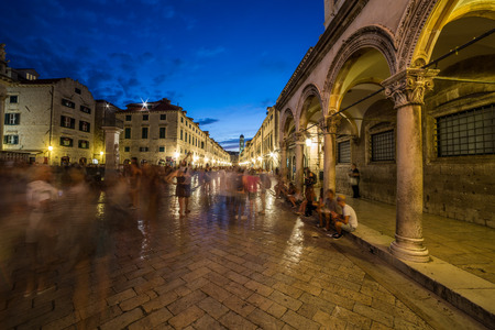 11th: DUBROVNIK, CROATIA - 11TH AUGUST 2016: A view along streets of Dubrovnik at night. The blur of people can  be seen.